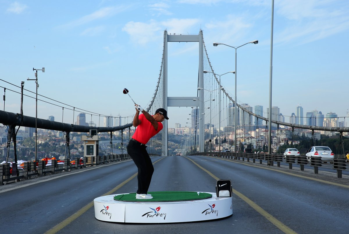tiger-woods-hitting-golf-ball-from-europe-to-asia